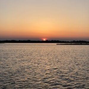 Sonnenuntergang über dem Fluessen (See)